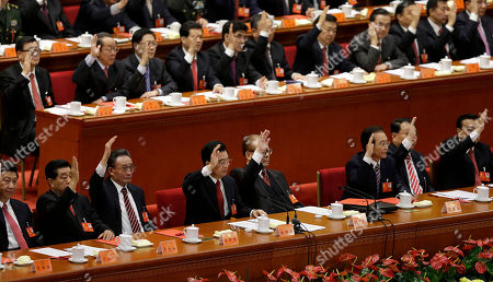 Xi Jinping, Jia Qinglin, Wu Bangguo, Hu Jintao, Jiang Zemin, Wen Jiabao, Li Keqiang, Li Changchun Chinese leaders from left, China Vice President Xi Jinping, Chairman of the Chinese People's Political Consultative Conference Jia Qinglin, National People's Congress Chairman Wu Bangguo, Chinese President Hu Jintao, former Chinese President Jiang Zemin, Chinese Premier Wen Jiabao, Propaganda chief Li Changchun and Vice Premier, Li Keqiang raise their hands to show approval for a work report at the closing ceremony of the 18th Communist Party Congress at the Great Hall of the People in Beijing