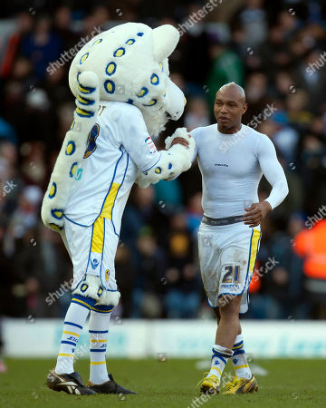 CAPTION CORRECTION CORRECTS THE DATE Leeds' El-Hadji Diouf is congratulated by the club's mascot after his team's 2-1 win over Tottenham in their English FA Cup fourth round soccer match at Elland Road Stadium, Leeds, England