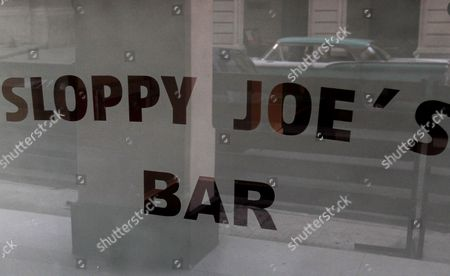A classic American car is reflected in the storefront window of Sloppy Joe's bar in Havana, Cuba, . Sloppy Joe's will be reopened in February 2013 by the state-owned tourism company Habaguanex, part of an ambitious revitalization project by the Havana City Historian's Office, which since the 1990's has transformed block after block of crumbling ruins into rehabilitated buildings along vibrant cobblestone streets, giving residents and tourists from all over the chance to belly up to the same bar that served thirsty celebrities like Rock Hudson, Babe Ruth and Ernest Hemingway