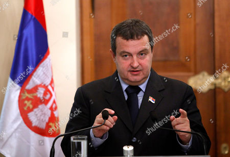 """Ivica Dacic Serbia's Prime Minister Ivica Dacic gestures as speaks to the media during a press conference after meeting with Cyprus' president Dimitris Christofias, unseen, at presidential palace in divided capital Nicosia, . Dacic said talks for his country to join the European Union could begin in March or June of next year at the latest depending on a favorable EU report expected to be issued soon. Dacic said Serbia """"has never before been so close to a date"""" for the start of EU accession talks"""