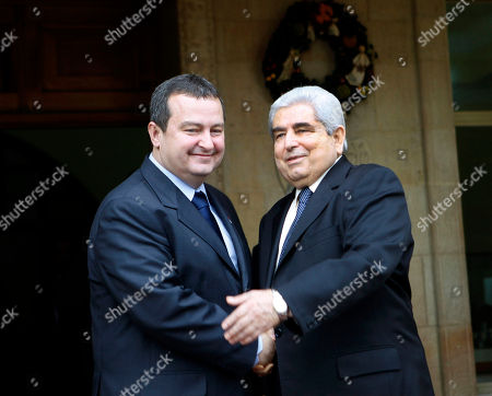 """Dimitris Christofias, Ivica Dacic Cyprus' president Dimitris Christofias, right, shakes hands with Serbia's Prime Minister Ivica Dacic after their meeting at presidential palace in divided capital Nicosia, . Dacic said talks for his country to join the European Union could begin in March or June of next year at the latest depending on a favorable EU report expected to be issued soon. Dacic said Serbia """"has never before been so close to a date"""" for the start of EU accession talks"""