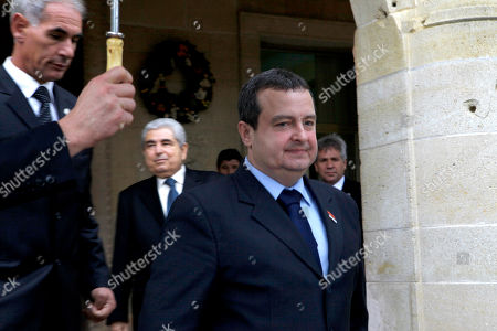 """Ivica Dacic, Dimitris Christofias Serbia's Prime Minister Ivica Dacic leaves the presidential palace after meeting with Cyprus' president Dimitris Christofias, rear, in divided capital Nicosia, . Dacic said talks for his country to join the European Union could begin in March or June of next year at the latest depending on a favorable EU report expected to be issued soon. Dacic said Serbia """"has never before been so close to a date"""" for the start of EU accession talks"""