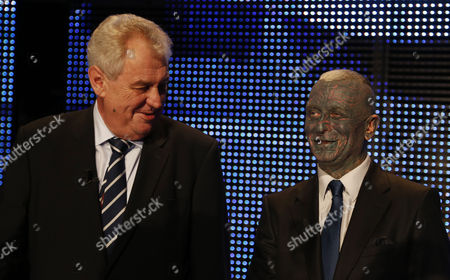 Presidential candidates Vladimir Franz, right, and Milos Zeman, left, talk prior their television debate in Prague, Czech Republic, . Czech Republic holds the first round of the Presidential election on Jan. 11-12th, 2013