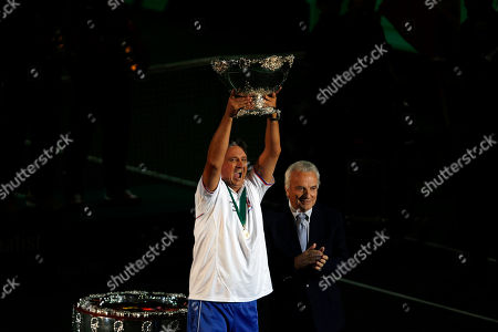 Czech Republic's Davis Cup team captain, Jaroslav Navratil, center, lifts the Davis Cup trophy as Francesco Ricci Bitti, the ITF president, looks on in Prague, Czech Republic, . The Czech Republic won the 2012 Davis Cup trophy by beating Spain 3-2