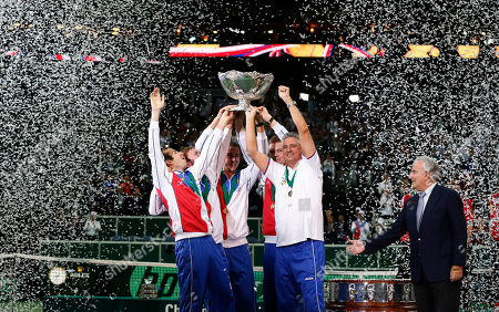 ITF President Francesco Ricci Bitti, right, presents Czech Republic's Davis Cup team with a trophy after their victory over Spain in their Davis Cup finals tennis match in Prague, Czech Republic