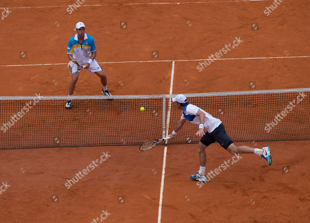Christopher Kas, Horacio Zeballos Germany's Christopher Kas, right, returns the ball to Argentina's Horacio Zeballos during a Davis Cup first-round doubles tennis match in Buenos Aires, Argentina