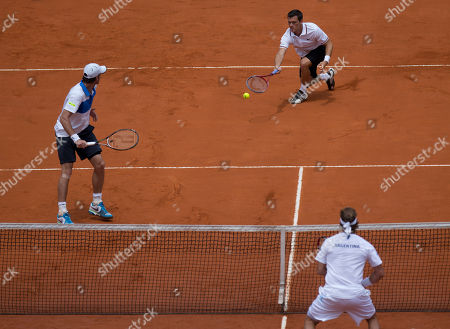 Tobias Kamke, Christopher Kas Germany's Tobias Kamke, top right, returns the ball to Argentina's David Nalbandian, as Germany's Christopher Kas, left, look on during a Davis Cup first-round doubles tennis match in Buenos Aires, Argentina
