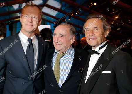Jacky Ickx, Claude Brasseur, Ari Vatanen Rallye driver Ari Vatanen, from Finland, left, Former Formula one pilot Jacky Ickx of Belgium, right, pose with French actor Claude Brasseur, center, at the concept cars exhibition within the 28th International Automobile Festival, in Paris