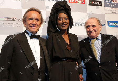 Jacky Ickx, Khadja Nin, Claude Brasseur Former Formula one pilot Jacky Ickx, left, and his wife Khadja Nin from Burundi, poses with French actor Claude Brasseur., right, at the concept cars exhibition within the 28th International Automobile Festival, in Paris