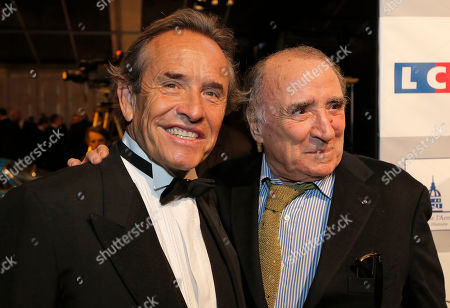 Jacky Ickx, Claude Brasseur Former Formula one pilot Jacky Ickx of Belgium, left, poses with French actor Claude Brasseur, right, at the concept cars exhibition within the 28th International Automobile Festival, in Paris