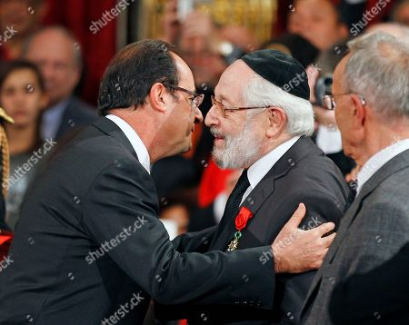 Francois Hollande, Alain Goldman French President Francois Hollande hugs Alain Goldman, the grand rabbi of Paris, after awarding him with the Grand Officier of the Legion of Honor medal during a ceremony at the Elysee Palace in Paris