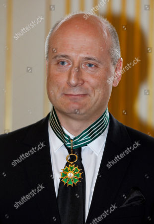 Stock Picture of Estonian-American conductor Paavo Jarvi poses for photographers after being made Commander of Arts and Letters at the French culture ministry in Paris
