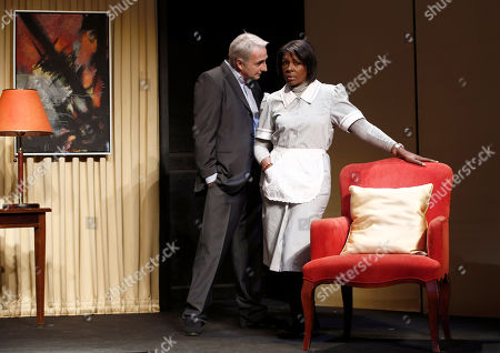 """French actor Eric Debrosse acting as former International Monetary Fund leader Dominique Strauss-Kahn, centre left, and actress Jelle Saminnadin acting as Nafissatou Diallo, the hotel housekeeper, who accused Dominique Strauss-Kahn of sexually assaulting her, pose during a photo opportunity as they perform in a play """"Suite 2806"""" in a Paris theatre. One-time French presidential hopeful Dominique Strauss Kahn has been to hell and back since he was charged, then acquitted in New York of making a hotel maid perform a sexual act in 2011. Now DSK will be treading the boards, in a salacious new play that recounts knock for knock what might have happened in the now infamous suite of the Manhattan Sofitel hotel"""