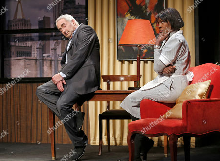 """French actor Eric Debrosse acting as former International Monetary Fund leader Dominique Strauss-Kahn, left, and actress Jelle Saminnadin acting as Nafissatou Diallo, the hotel housekeeper, who accused Dominique Strauss-Kahn of sexually assaulting her, pose during a photo opportunity as they perform in a play """"Suite 2806"""" in a Paris theatre. One-time French presidential hopeful Dominique Strauss Kahn has been to hell and back since he was charged, then acquitted in New York of making a hotel maid perform a sexual act in 2011. Now DSK will be treading the boards, in a salacious new play that recounts knock for knock what might have happened in the now infamous suite of the Manhattan Sofitel hotel"""