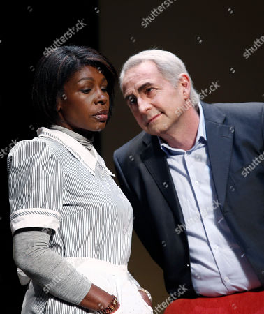"""French actor Eric Debrosse acting as former International Monetary Fund leader Dominique Strauss-Kahn, right, and actress Jelle Saminnadin acting as Nafissatou Diallo, the hotel housekeeper, who accused Dominique Strauss-Kahn of sexually assaulting her, pose during a photo opportunity as they perform in a play """"Suite 2806"""" in a Paris theatre. One-time French presidential hopeful Dominique Strauss Kahn has been to hell and back since he was charged, then acquitted in New York of making a hotel maid perform a sexual act in 2011. Now DSK will be treading the boards, in a salacious new play that recounts knock for knock what might have happened in the now infamous suite of the Manhattan Sofitel hotel"""
