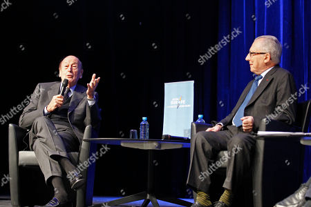 Former French President Valery Giscard d'Estaing, left, delivers his speech as former European Commission president Jacques Delors, right, looks, during a conference on Europe, attended by students, in Paris