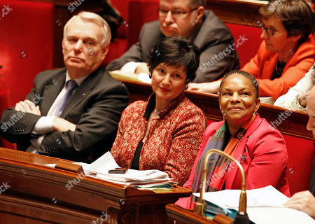 French justice minister Christiane Taubira, right, sits on the government bench with social affairs minister Dominique Bertinotti, center, and prime minister Jean Marc Ayrault, during the vote at the National Assembly in Paris, of a new law legalizing gay marriage. France's lower house of parliament has approved a sweeping bill to legalize gay marriage and allow same-sex couples to adopt children. President Francois Hollande's Socialists have pushed the measure through the National Assembly and put France on track to join about a dozen, mostly European nations that grant marriage and adoption rights to homosexuals