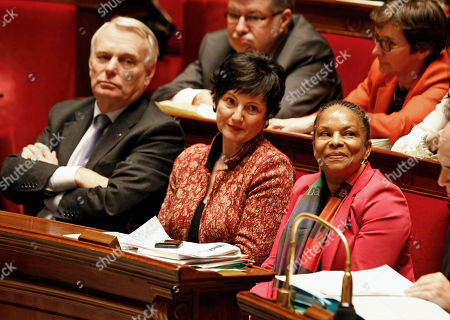 Stock Picture of FILE, this file image shows French justice minister Christiane Taubira, right, sitting on the government bench with social affairs minister Dominique Bertinotti, center, and prime minister Jean Marc Ayrault, during the vote at the National Assembly in Paris, of a new law legalizing gay marriage. France's constitutional council has rejected a challenge by conservative lawmakers to the country's new gay marriage law, saying the law was constitutional. That means France could see its first gay marriages by the end of May