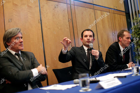 """French Junior Minister for Consumption Benoit Hamon, center, French Agriculture Minister Stephane Le Foll, left, and Junior Minister for food-processing Guillaume Garot, right, give a press conference, in Paris, . A maze of trading between meat wholesalers has made it increasingly difficult to trace the origins of food, enabling horsemeat disguised as beef to be sold in frozen meals across Europe. France's agricultural minister said Monday that regulators must find a way """"out of the fog"""