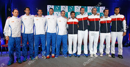 Davis Cup Israeli team members, left, pose with the French team members, right, at the draw ceremony for the first round of the Davis Cup between Israel and France, in Rouen, western France, . Israeli players are from left, Dudi Sela, Amir Weintraub, Jonathan Erlich, Noam Okun, and team captain Eyal Ran. French players are from right, Jo Wilfried Tsonga, Richard Gasquet, Julien Benetteau, Michael Llodra, and team captain Arnaud Clement. The Israeli and French teams will play Friday Feb. !st to Sunday Feb. 3, at the Rouen Kinarena