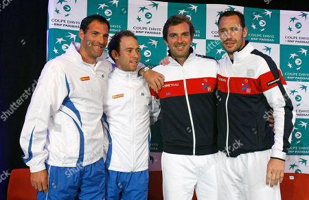 Davis Cup Israeli team members Jonathan Erlich, left, and Dudi Sela, second from left, pose with French team members Julien Benetteau and Michael Llodra, right, at the draw ceremony for the first round of the Davis Cup between Israeli and France, in Rouen, western France, . The two pairs will play their double match on Saturday Feb. 2. The Israeli and French teams will play Friday Feb. !st to Sunday Feb. 3, at the Rouen Kinarena