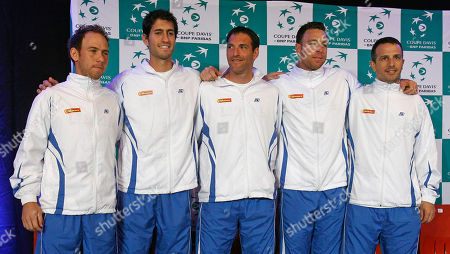 Davis Cup Israeli team members pose at the draw ceremony for the first round of the Davis Cup between Israel and France, in Rouen, western France, . Israeli players are from left, Dudi Sela, Amir Weintraub, Jonathan Erlich, Noam Okun, and team captain Eyal Ran. The Israeli and French teams will play from Friday Feb. 1 to Sunday Feb. 3, at the Rouen Kinarena