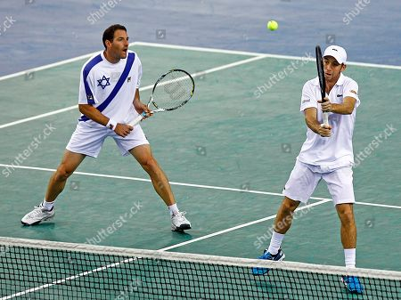 Israeli player Dudi Sela, right, returns the ball as Jonathan Erlich, looks, during their double match against French pair Michael Llodra and Julien Benetteau on the first round of the Davis Cup between Israeli and France, in Rouen, western France, . Llodra and Benetteau won the match, qualifying France for the next round on a 3-0 score