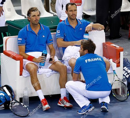 Stock Photo of French player Michael Llodra, right, and Julien Benetteau, left, listen to team captain Arnaud Clement, during their double match against Israeli pair Dudi Sela and Jonathan Erlich, on the first round of the Davis Cup between Israeli and France, in Rouen, western France, . Llodra and Benetteau won the match qualifying France for the next round on a 3-0 score