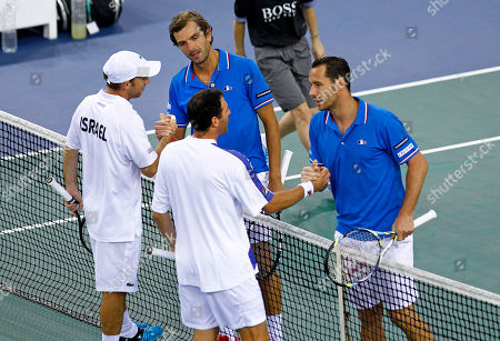 The French pair Michael Llodra, right, and Julien Benetteau, shakes hand with the Israeli pair Dudi Sela, left, and Jonathan Erlich after winning their double match, in the first round of the Davis Cup between Israel and France, in Rouen, western France, . France wins the first round on a 3-0 score