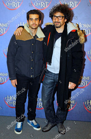 Radu Mihaileanu Romanian-born French film director Radu Mihaileanu, right, poses with his son Gary, as he arrives at the screening of L'Homme qui rit, a movie by French film director Jean Pierre Ameris, in Paris