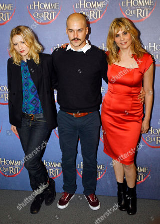 Emmanuelle Seigner, Christa Theret, Marc Andre Grondin French actresses Emmanuelle Seigner, right, and Christa Theret, left, pose for photographers with Canadian actor Marc Andre Grondin, center, as they arrive at the screening of L'Homme qui rit, a movie by French film director Jean Pierre Ameris, in Paris