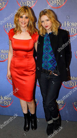 Emmanuelle Seigner, Christa Theret French actresses Emmanuelle Seigner, left, and Christa Theret, right, pose for photographers as they arrive at the screening of L'Homme qui rit, a movie by French film director Jean Pierre Ameris, in Paris