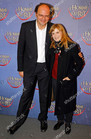 Jean Pierre Ameris, Isabelle Carre French film director Jean Pierre Ameris, left, poses for photographers with French actress Isabelle Carre, as they arrive at the screening of L'Homme qui rit, a movie by Jean Pierre Ameris, in Paris