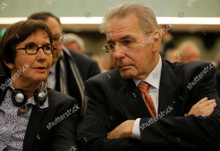 """Jacques Rogge, Valerie Fourneyron International Olympic Commitee President Jacques Rogge, right, listens to French Sports minister Valerie Fourneyron during a symposium called """"The Pharmaceutical Industry and the Fight against Doping : New Partnerships for Clean Sport"""" in Paris . The international conference is looking at ways to unite the pharmaceutical industry and sports authorites in the fight against doping"""