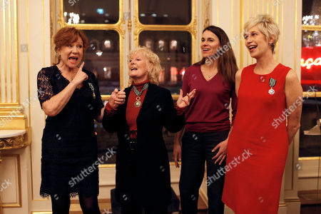From left, French actress Eva Darlan, British singer Petula Clark, French culture Minister Aurelie Filippetti, and U.S. born singer Valli sing during a ceremony held at the French culture ministry in Paris