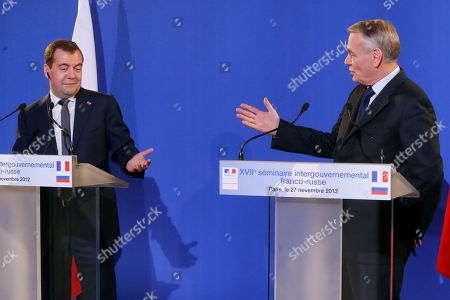 Jean-Marc Ayrault, Dimitry Medvedev Russian Prime Minister Dmitry Medvedev, left, and French Prime Minister Jean-Marc Ayrault react during a joint press conference at Quai d'Orsay in Paris