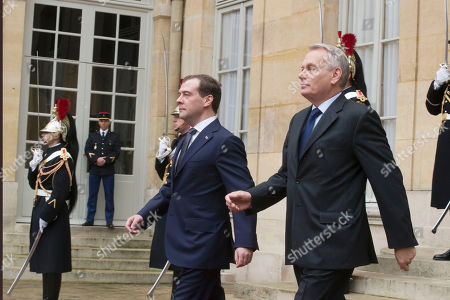 Jean-Marc Ayrault, Dimitry Medvedev Russian Prime Minister Dmitry Medvedev, left, and French Prime Minister Jean-Marc Ayrault leave Matignon after a meeting in Paris