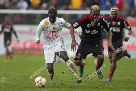 Stock Picture of Bernard Mendy, Jordan Ayew Marseille's forward Jordan Ayew of Ghana challenges for the ball with Brest's french defender Bernard Mendy during their French League One soccer match against Brest, in Brest, western France