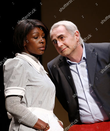 """French actor Eric Debrosse playing the role of former International Monetary Fund leader, Dominique Strauss-Kahn, right, and actress Jelle Saminnadin as Nafissatou Diallo, the hotel housekeeper who accused Dominique Strauss-Kahn of sexually assaulting her, pose during a photo opportunity as they act in a play """"Suite 2806"""" in a Paris theatre, . The show will start on Nov. 21 at the theatre Daunou in Paris"""