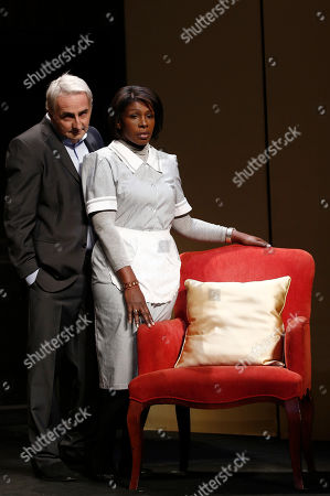 """French actor Eric Debrosse playing the role of former International Monetary Fund leader, Dominique Strauss-Kahn, left, and actress Jelle Saminnadin as Nafissatou Diallo, the hotel housekeeper who accused Dominique Strauss-Kahn of sexually assaulting her, pose during a photo opportunity as they act in a play """"Suite 2806"""" in a Paris theatre, . The show will start on Nov. 21 at the theatre Daunou in Paris"""