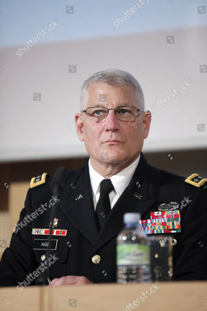 Stock Image of The head of the U.S. Africa Command, General Carter Ham, attends to a debate in the University of Sciences Politiques, in Paris, . Some of the culprits in an attack on the U.S. consulate in Benghazi, Libya, had links to al-Qaida's North Africa arm, a top U.S. military official said Wednesday, adding that it remained unclear if the terror network led or organized the deadly assault whose victims included an American ambassador. Al-Qaida links had been suspected in the attack on Sept. 11, but not publicly detailed, and an investigation is underway. U.S. Ambassador to Libya Chris Stevens and three others were killed. The assault occurred around the same time that protests erupted in Muslim countries over an anti-Islam film made in the United States. Gen. Carter Ham, the head of the U.S. military's Africa Command, said some of the attackers had ties to Al-Qaida in the Islamic Maghreb, which was built on the remains of a former Algerian militant group