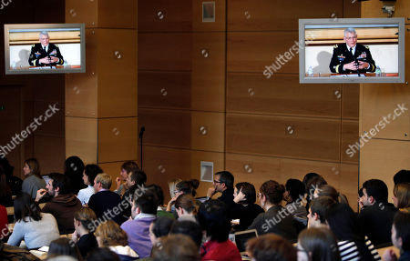 Stock Photo of People listen to the debate given by the head of the U.S. Africa Command, General Carter Ham, on screens, in the University of Sciences Politiques, in Paris, . Gen. Some of the culprits in an attack on the U.S. consulate in Benghazi, Libya, had links to al-Qaida's North Africa arm, a top U.S. military official said Wednesday, adding that it remained unclear if the terror network led or organized the deadly assault whose victims included an American ambassador. Al-Qaida links had been suspected in the attack on Sept. 11, but not publicly detailed, and an investigation is underway. U.S. Ambassador to Libya Chris Stevens and three others were killed. The assault occurred around the same time that protests erupted in Muslim countries over an anti-Islam film made in the United States. Gen. Carter Ham, the head of the U.S. military's Africa Command, said some of the attackers had ties to Al-Qaida in the Islamic Maghreb, which was built on the remains of a former Algerian militant group