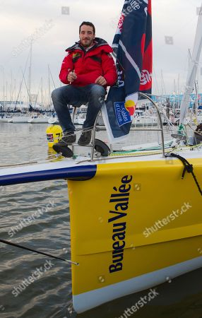 Stock Photo of French skipper Louis Burton poses for photographers during preparations ahead of the Vendee Globe sailing race at Les Sables d'Olonne Western France . The Vendee Globe sailing race, an around-the-world solo race that's held every four years, will start next Saturday