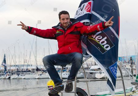 Stock Image of French skipper Louis Burton poses for photographers during preparations ahead of the Vendee Globe sailing race at Les Sables d'Olonne Western France . The Vendee Globe sailing race, an around-the-world solo race that's held every four years, will start next Saturday