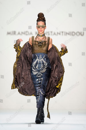 A model presents a creation of designer Miranda Konstantinidou as part of the Mercedes Benz Fashion Week for autumn/winter 2013 in Berlin