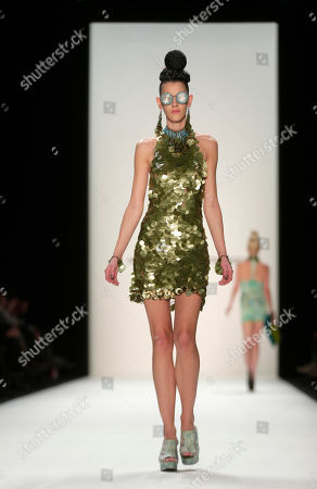 A model presents a creation by designer Miranda Konstantinidou as part of the Mercedes Benz Fashion Week for autumn winter 2013 in Berlin