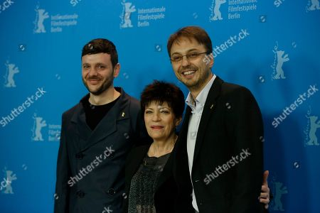 Stock Photo of From left actors Bogdan Dumitrache, Luminita Gheorghiu and Director and producer Calin Peter Netzer pose during the photo call for the film Child's Pose at the 63rd edition of the Berlinale, International Film Festival in Berlin