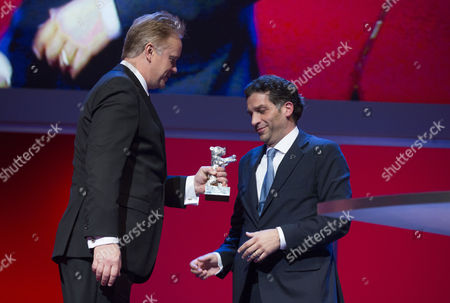 Tim Robbins, Danis Tanovic Actor Tim Robbins, left, presents director Danis Tanovic with his Silver Bear Jury Grand Prix for his film in An Episode In the Life of an Iron Picker, at the closing ceremony at the 63rd edition of the Berlinale, International Film Festival in Berlin