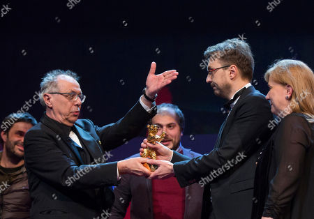 Calin Peter Netzer Festival director Dieter Kosslick, left, presents director Calin Peter Netzer with the Golden Bear for his film Child's Pose at the closing ceremony at the 63rd edition of the Berlinale, International Film Festival in Berlin