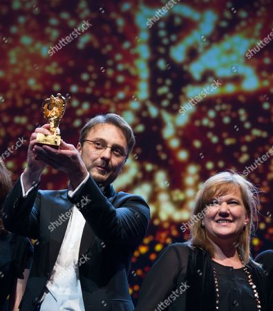 Director Calin Peter Netzer holds the Golden Bear for his film Child's Pose alongside producer Ada Solomon at the closing ceremony at the 63rd edition of the Berlinale, International Film Festival in Berlin